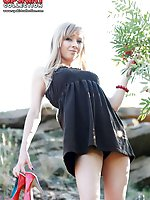 Upskirt pictures - Blonde bimbo shows panty up skirt
